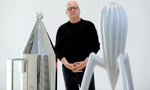 Alberto Alessi, owner of kitchenware firm Alessi, with giant mock-up of lemon squeezer